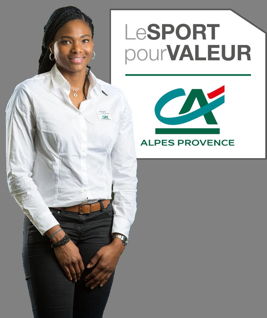 """Muriel Hurtis, ambassadrice debout à coté du slogan """"Le Sport pour Valeur"""""""