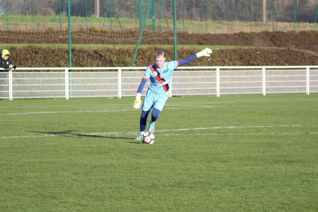 Lucas Alexandre sur le terrain en action pendant un match